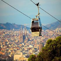 360º Barcelona eBike: city ride on eBike with Cable Car ticket, Sailing trip & skip the line tickets to Sagrada Familia (FD)