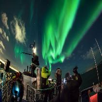 Northern Lights by boat with Official Guide and Transportation